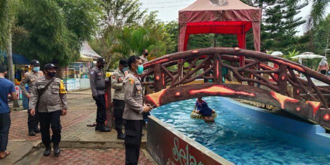 Polisi Lhokseumawe Lakukan Pengawasan Protokol Kesehatan Di tempat Wisata